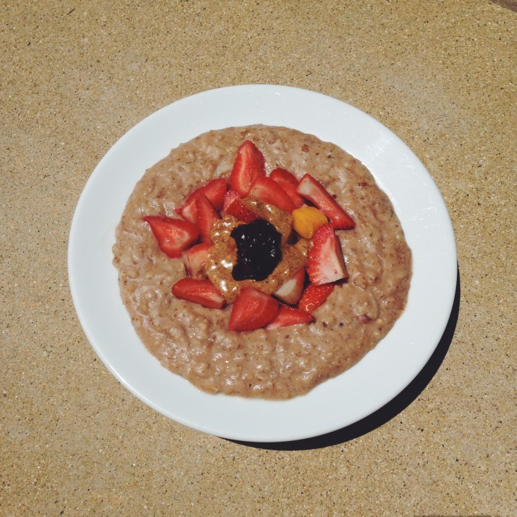 THURSDAY: Simple Chocolate Oatmeal with strawberries, melted vegan dark chocolate and mangoes